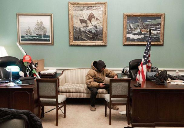 PHOTO: Supporters of President Donald Trump sit inside the office of Speaker of the House Nancy Pelosi as they protest inside the US Capitol in Washington, D.C., Jan. 6, 2021. (Saul Loeb/AFP via Getty Images)