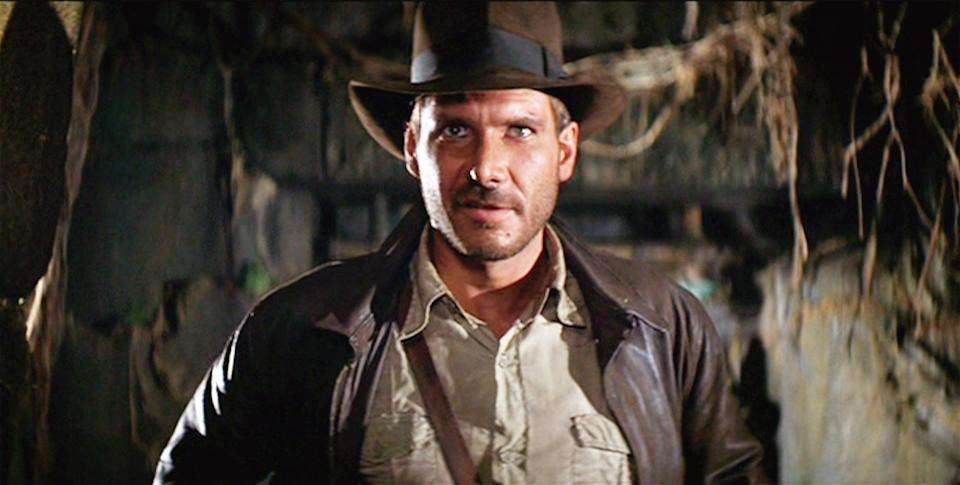 """LOS ANGELES - JUNE 12: The movie: Indiana Jones and the Raiders of the Lost Ark , (aka: """"Raiders of the Lost Ark""""), directed by Steven Spielberg.  Seen here, Harrison Ford as Indiana Jones.  Initial theatrical release June 12, 1981.  Screen capture. A Paramount Picture. (Photo by CBS via Getty Images)"""