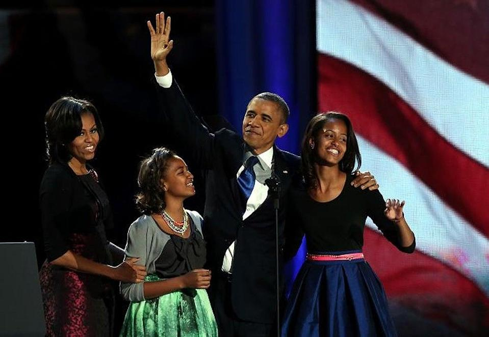 <p>Michelle and Barack Obama with their daughters Sasha and Malia in Chicago.</p> (Win McNamee/Getty Images)