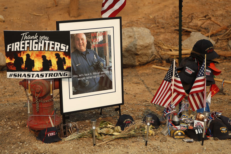 This Aug. 10, 2018 photo shows a memorial for Jeremy Stoke of the Redding Fire Department, in Redding, Calif. The California Department of Forestry and Fire Protection says in a report that Redding firefighter Stoke, 37, died July 26, 2018, after he was enveloped in seconds by a fire tornado with a base the size of three football fields and winds up to 165 miles an hour. (AP Photo/John Locher)