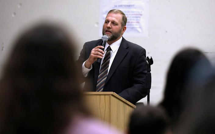 Libertarian activist Ammon Bundy speaks during an Easter Sunday church service he organized despite concerns over coronavirus disease (COVID-19) in Emmett, Idaho, U.S. April 12, 2020. (Jim Urquhart/Reuters)