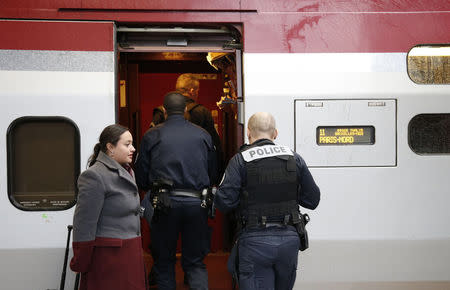 French police officers embark in a Thalys high speed train at Brussels Midi railway in Brussels, November 21, 2015. REUTERS/Francois Lenoir