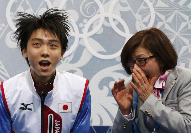 """Japan's Yuzuru Hanyu reacts in the """"kiss and cry"""" area during the Figure Skating Men's Short Program at the Sochi 2014 Winter Olympics"""