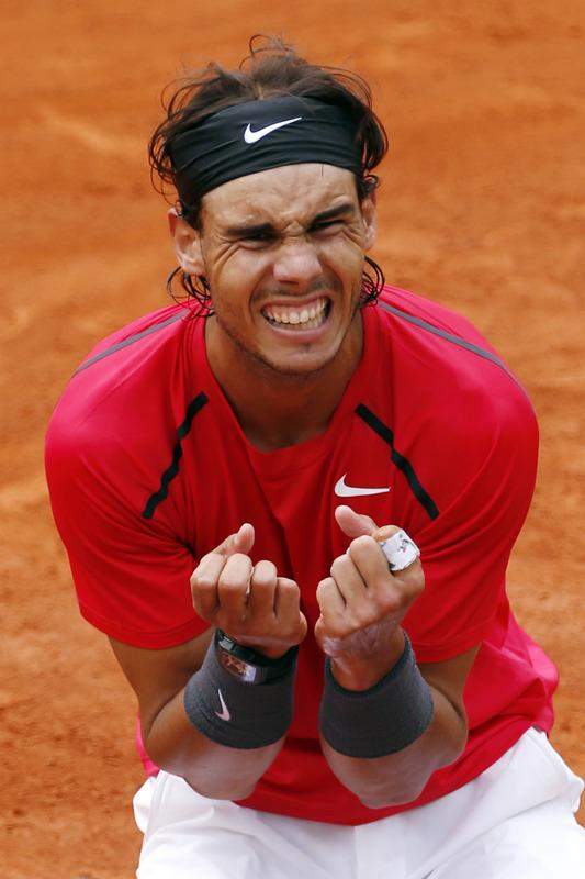 TOPSHOTS Spain's Rafael Nadal celebrates after winning against Serbia's Novak Djokovic their Men's Singles final tennis match during the French Open tennis tournament at the Roland Garros stadium, on June 11, 2012 in Paris.    AFP PHOTO / THOMAS COEXTHOMAS COEX/AFP/GettyImages