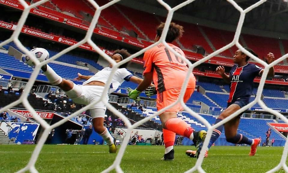 Lyon's Wendie Renard (left) stretches but can only deflect the ball into her own net.