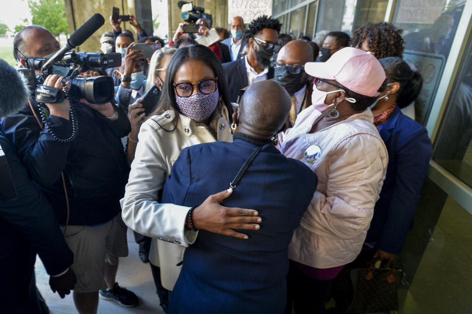 Rochester Mayor Lovely Warren, left, is greeted by supporters after her arraignment in city court in Rochester, N.Y., Monday, Oct. 5, 2020. Warren, who has faced calls to resign over her city's handling of the suffocation death of Daniel Prude at the hands of police, pleaded not guilty Monday to campaign finance charges dating to her 2017 reelection campaign. (AP Photo/Adrian Kraus)