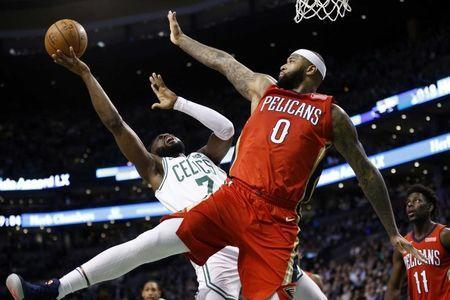 Jan 16, 2018; Boston, MA, USA; Boston Celtics guard Jaylen Brown (7) is defended by New Orleans Pelicans forward DeMarcus Cousins (0) during the second half at TD Garden. Mandatory Credit: Greg M. Cooper-USA TODAY Sports