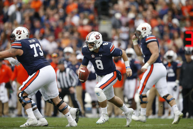 "Auburn quarterback <a class=""link rapid-noclick-resp"" href=""/ncaaf/players/251133/"" data-ylk=""slk:Jarrett Stidham"">Jarrett Stidham</a> (8) runs the ball during the first half of the Iron Bowl NCAA college football game against Alabama, Saturday, Nov. 25, 2017, in Auburn, Ala. (AP Photo/Brynn Anderson)"
