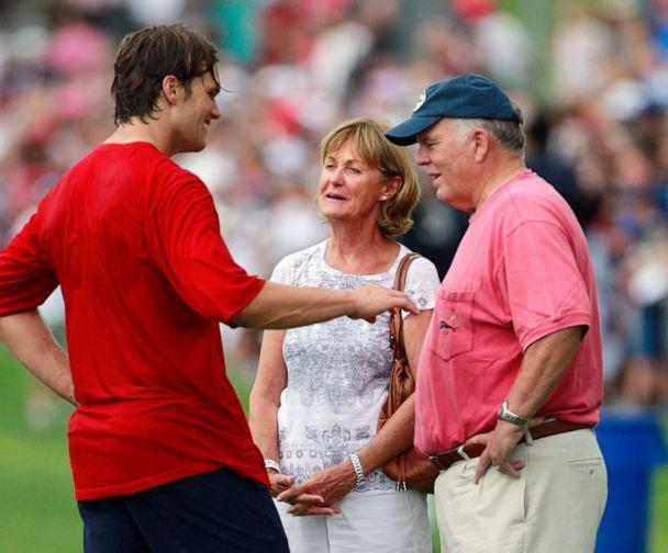 PHOTO: New England Patriots' Tom Brady, left, talks with his parents Galynn, center and Tom, after NFL football training camp in Foxborough, Mass., Aug. 9, 2011. (Michael Dwyer/AP, FILE)
