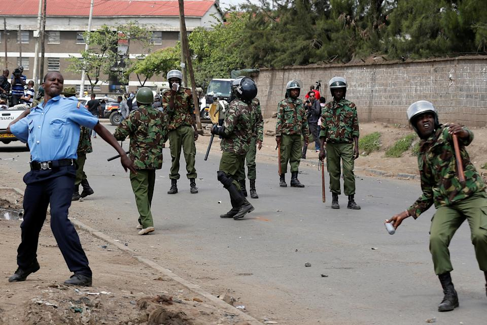 <p>Policemen attempt to disperse supporters of Kenyan opposition leader Raila Odinga of the National Super Alliance (NASA) coalition along Likoni road as they are repulsed from accessing city center, in Nairobi, Kenya, Nov. 17, 2017. (Photo: Thomas Mukoya/Reuters) </p>