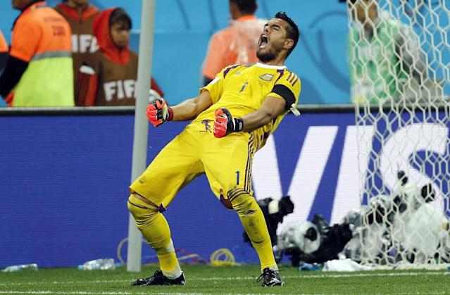 Argentina's goalkeeper Sergio Romero celebrates after he saved shot by Netherlands' Wesley Sneijder from the spot during the World Cup semifinal soccer match between the Netherlands and Argentina at the Itaquerao Stadium in Sao Paulo, Brazil, Wednesday, July 9, 2014. Argentina beat the Netherlands 4-2 in a penalty shootout to reach the World Cup final. (AP Photo/Frank Augstein)
