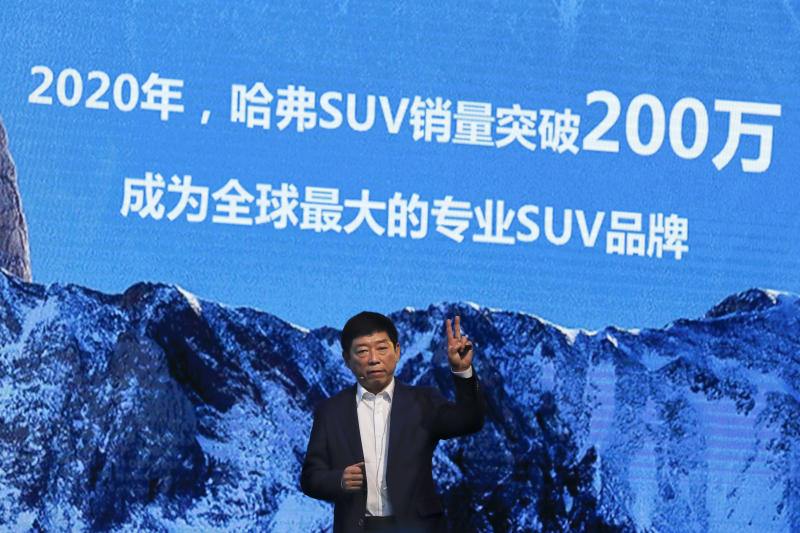 "FILE - In this Feb. 19, 2017, file photo, Wei Jianjun, chairman of Great Wall Motors Ltd., gestures as he speaks during an event celebrating it sales passing the one million mark, at the Great Wall headquarters in Baoding in north China's Hebei province. General Motors decision to pull out of Australia, New Zealand and Thailand as part of a strategy to exit markets that don't produce adequate returns on investments raised dismay Monday, Feb. 17, 2020 from officials concerned over job losses.  The words behind reads ""By 2020, Haval SUV sales will pass 2 million, become the world's biggest specialty SUV brand."" (AP Photo/Andy Wong)"
