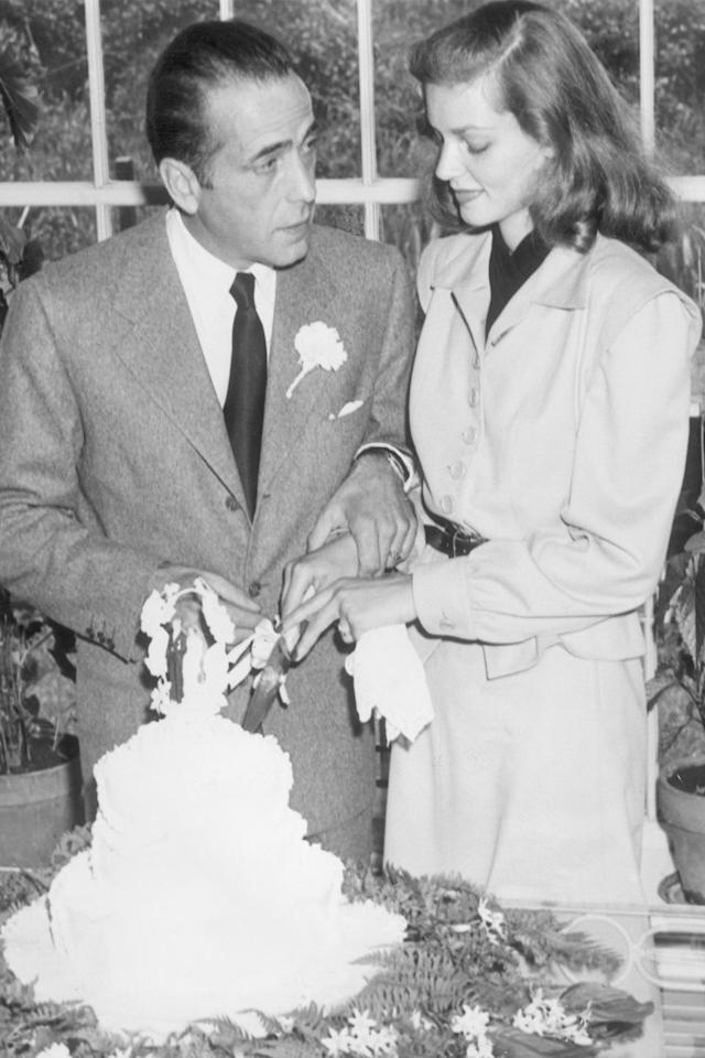 <p>Even though Lauren Bacall is an old-Hollywood actress known for her sultry looks, she skipped the big white dress and wore a beige skirt-suit and black leather belt for her wedding to Humphrey Bogart (who also happened to be 25 years her senior).</p>
