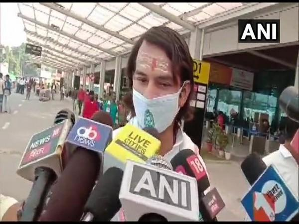 RJD leader Tej Pratap Yadav talks to reporters on Thursday. (Photo/ANI)