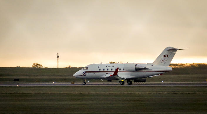 A Canadian Forces Challenger jet takes off from the Calgary International Airport in Calgary after two Canadians who were imprisoned in China for nearly three years returned, , Saturday, Sept. 25, 2021. Video from CTV shows Prime Minister Justin Trudeau greeting Michael Kovrig and Michael Spavor on the tarmac at the airport in Calgary early this morning. (Jeff McIntosh/The Canadian Press via AP)