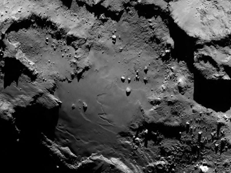 A handout photo released by the European Space Agency shows a close up view of a smooth region of Comet 67P/Churyumov-Gerasimenko, taken by the Rosetta spacecraft (AFP Photo/)