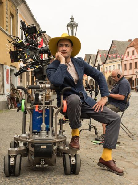 """This image released by Fox Searchlight Pictures shows Writer/Director Taika Waititi on the set of """"Jojo Rabbit."""" On Monday, Jan. 13, Waititi was nominated for an Oscar for adapted screenplay for his work on the film. (Kimberley French/Fox Searchlight Pictures via AP)"""