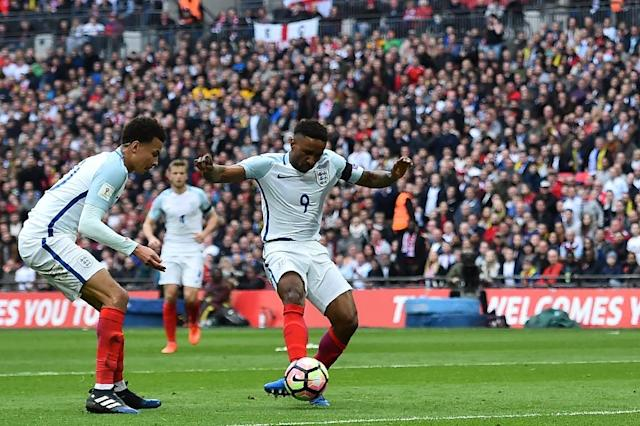 England's striker Jermain Defoe (C) shoots to score his team's first goal during the World Cup 2018 qualification football match between England and Lithuania at Wembley Stadium in London on March 26, 2017 (AFP Photo/Glyn KIRK )