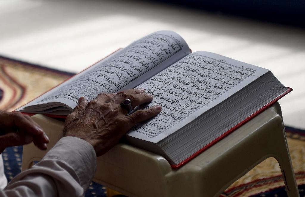 An 18-year-old was charged under section 295-B of Pakistan's penal code, referring to a part of the country's constitution that makes the death sentence mandatory for anyone who damages or desecrates the Quran (AFP Photo/RIZWAN TABASSUM)