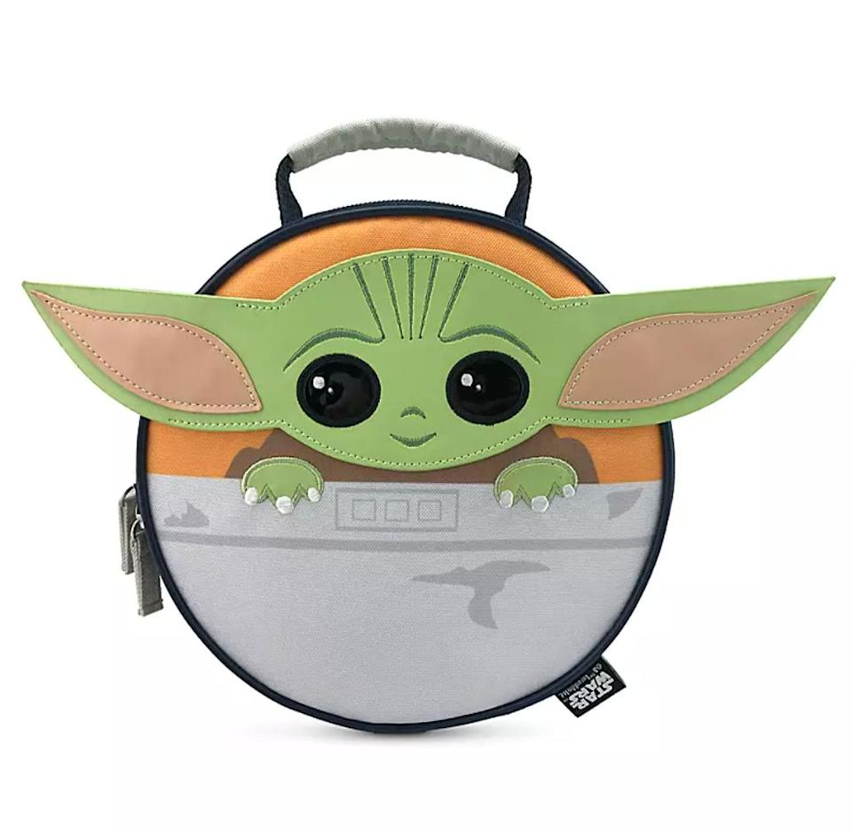 """Whether they're doing long-distance learning this year or taking classes IRL, the kid in your life will love this little lunch box that features Baby Yoda's big eyes and ears. It has an interior ID label so that they don't lose it.<a href=""""https://fave.co/36lCuqI"""" target=""""_blank"""" rel=""""noopener noreferrer"""">Find it for $17 at shopDisney</a>."""