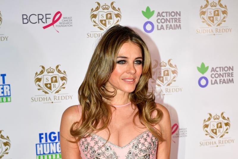 British actress Liz Hurley poses during a photocall in Paris on December 11, 2017 during a charity dinner in honour of Indian billionaire Sudha Reddy, who donated to Hurley's Breast Cancer Research Foundation and to the Fight Hunger foundation. / AFP PHOTO / Martin BUREAU (Photo credit should read MARTIN BUREAU/AFP via Getty Images)