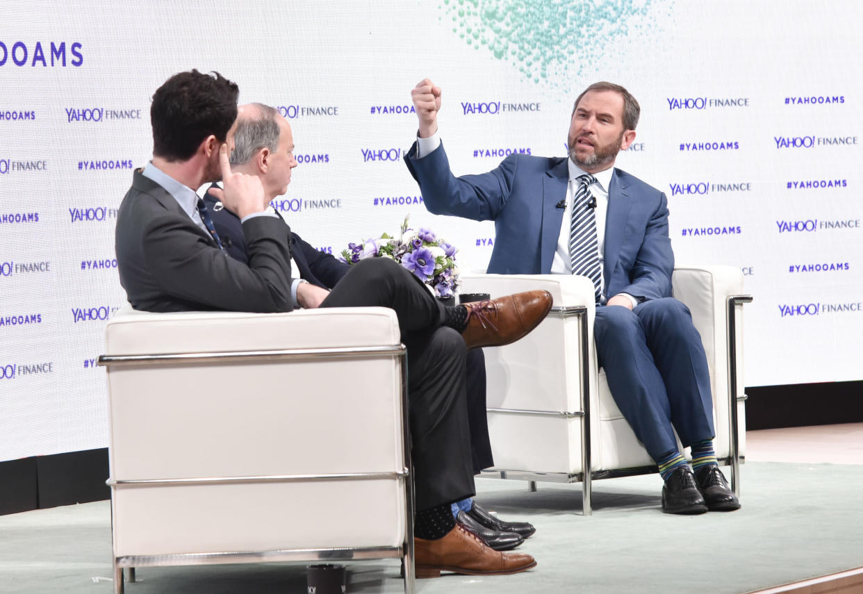 NEW YORK, NY - FEBRUARY 07:  Dan Roberts, Brad Garlinghouse, and Andy Serwer attend the Yahoo Finance All Markets Summit: Crypto on February 7, 2018 in New York City.  (Photo by Eugene Gologursky/Getty Images for Yahoo Finance/Oath )