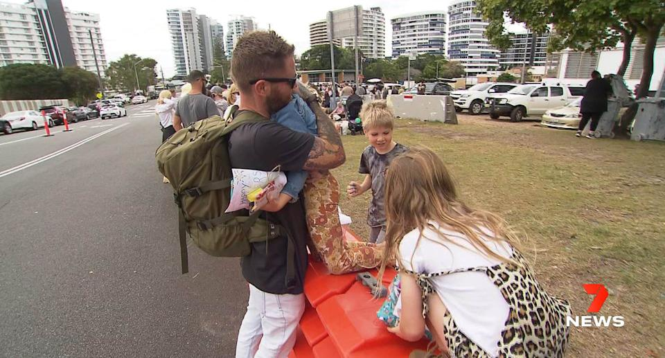 """Images showing families gathering at the border between Queensland and New South Wales to celebrate Father's Day have been slammed as """"insane"""". Source: 7News Australia"""
