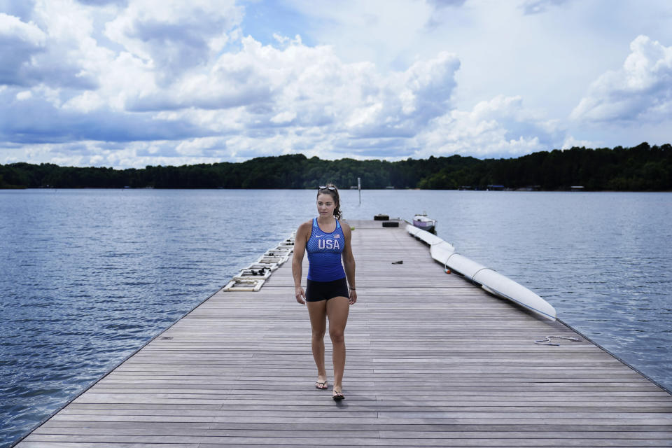 Canoe sprint world champion Nevin Harrison, 19, of Seattle, walks off the deck before she trains near Lake Lanier Olympic Park on Thursday, July 1, 2021, in Gainesville, Ga. Harrison won the world championship in the women's sprint canoe 200 meters as a 17-year-old in 2019. Now she'll try to duplicate that at the Olympics in Tokyo where the race will be a new event in a bid for gender equity. (AP Photo/Brynn Anderson)