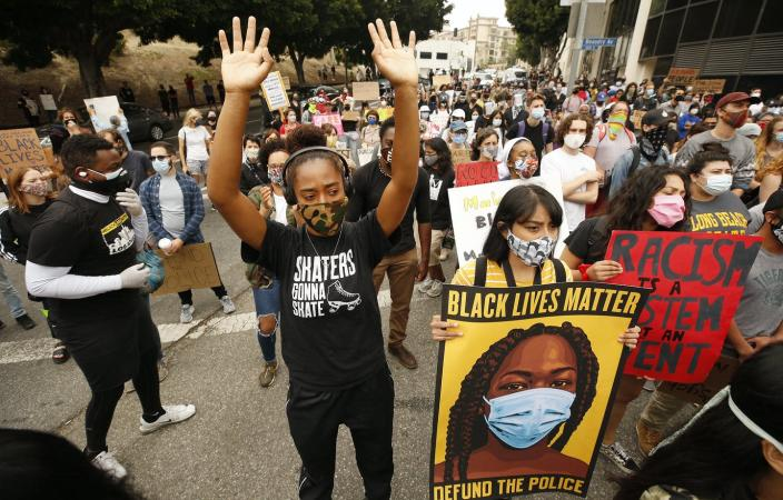 "<span class=""caption"">Will protests on campus look different after COVID-19?</span> <span class=""attribution""><a class=""link rapid-noclick-resp"" href=""https://www.gettyimages.com/detail/news-photo/liliana-ruiz-left-and-jacqueline-ramirez-middle-join-news-photo/1222449974?adppopup=true"" rel=""nofollow noopener"" target=""_blank"" data-ylk=""slk:Al Seib/Getty Images"">Al Seib/Getty Images</a></span>"