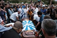 "People attend the funeral of Marcos Vieira de Souza, known as ""Falcon"", a Progressive Party (PP) candidate for Rio de Janeiro city councillor, at the Jardim da saudade cemetery in Rio de Janeiro on September 27, 2016 after he was shot dead (AFP Photo/Yasuyoshi Chiba)"
