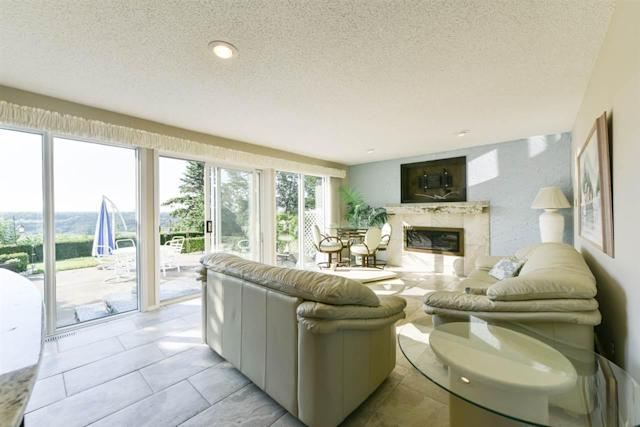 <p><span>4204 Whitemud Rd. NW, Edmonton, Alta.</span><br> The ground floor has a walkout to the patio, plus full wet bar and gas fireplace.<br> (Photo: Zoocasa) </p>