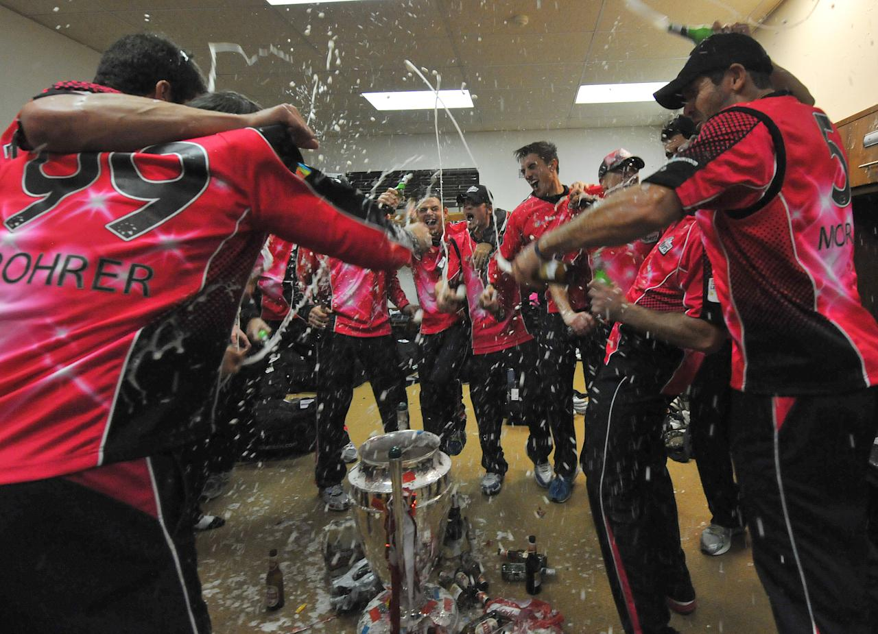 JOHANNESBURG, SOUTH AFRICA - OCTOBER 28: (SOUTH AFRICA OUT) The Sydney Sixers celebrate after winning the Karbonn Smart CLT20 Final match between bizhub Highveld Lions and Sydney Sixers at Bidvest Wanderers Stadium on October 28, 2012 in Johannesburg, South Africa. (Photo by Duif du Toit/Gallo Images/Getty Images)