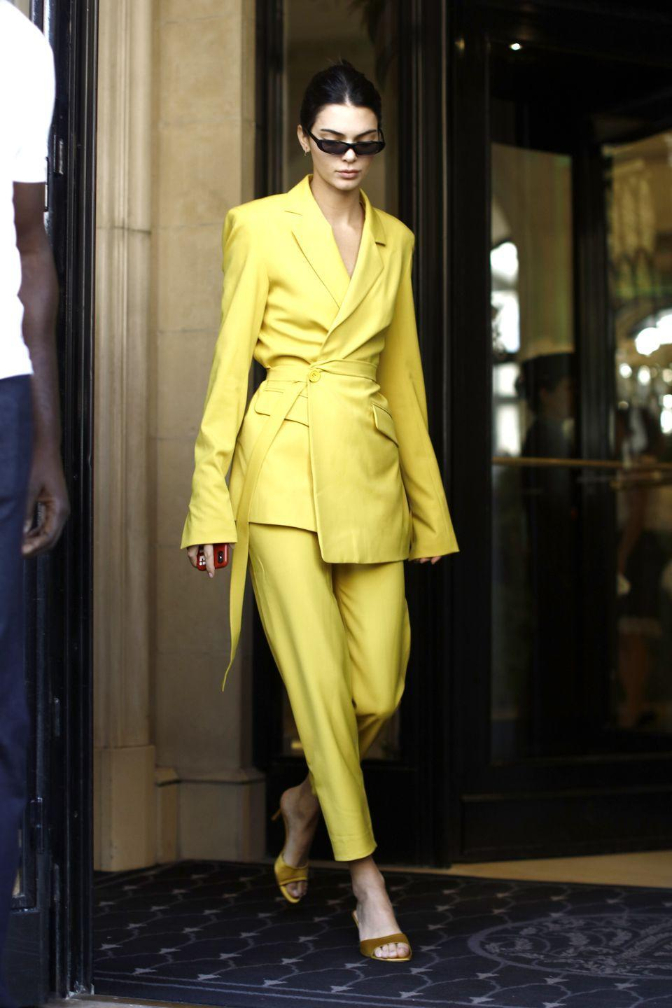 <p>The model wore a yellow House of Holland suit whilst out and about in Paris.</p>