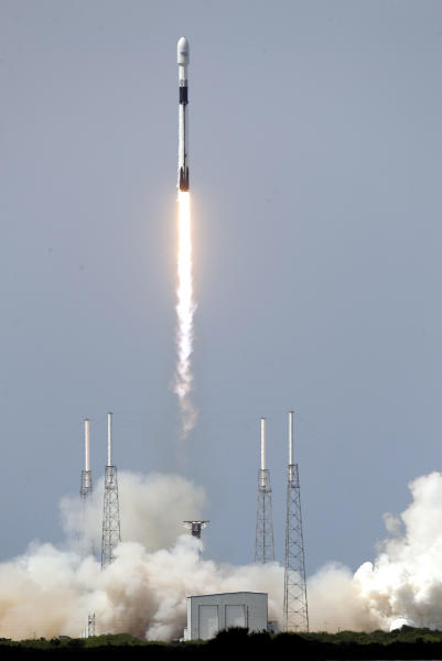 A Falcon 9 SpaceX rocket, with a global positioning satellite for the U.S. Space Force, lifts off from launch complex 40 at the Cape Canaveral Air Force Station in Cape Canaveral, Fla., Tuesday, June 30, 2020. (AP Photo/John Raoux)