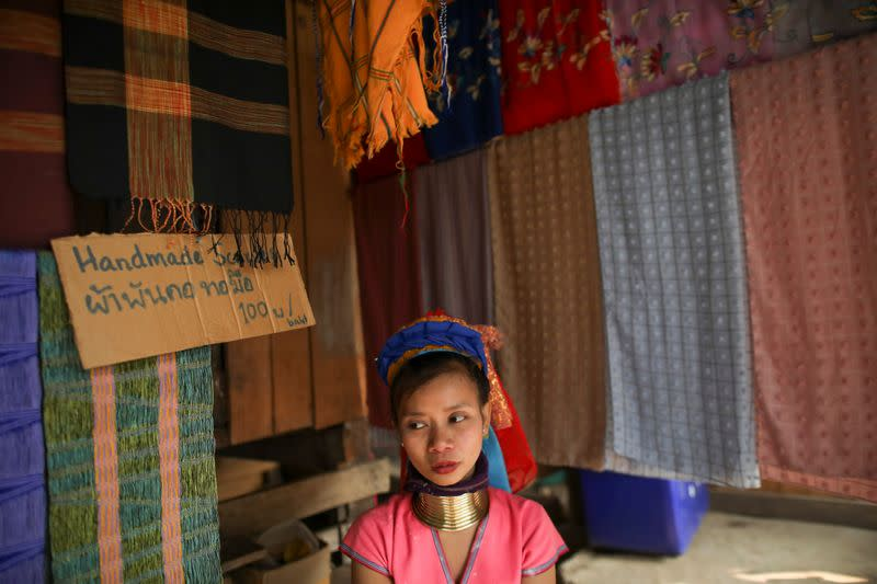 A woman sells clothes in the Kayan village where people, who fled from Myanmar during the 1990s war between Myanmar's army and ethnic army groups, live in Mae Hong Son