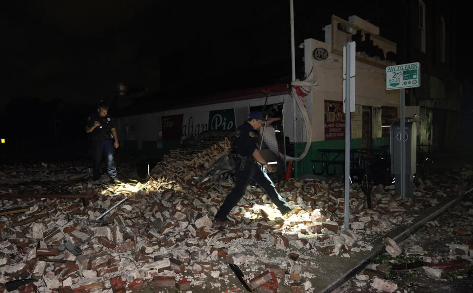Police look through debris after a building collapsed from the effects of Hurricane Ida, Monday, Aug. 30, 2021, in New Orleans, La. (AP Photo/Eric Gay)
