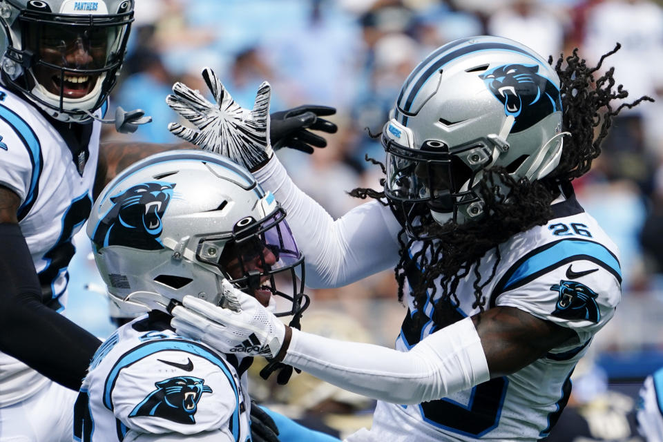 Carolina Panthers defensive end Brian Burns celebrates after a sack with cornerback Donte Jackson during the second half of an NFL football game against the New Orleans Saints Sunday, Sept. 19, 2021, in Charlotte, N.C. (AP Photo/Jacob Kupferman)