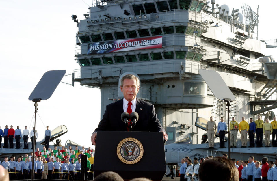 FILE - President Bush declares the end of major combat in Iraq as he speaks aboard the aircraft carrier USS Abraham Lincoln off the California coast, in this May 1, 2003 file photo. The former Soviet Union marched into Afghanistan on Christmas Eve, 1979, claiming it was invited by the new Afghan communist leader, Babrak Karmal, setting the country on a path of 40 years of seemingly endless wars and conflict. After the Soviets left in humiliation, America was the next great power to wade in. (AP Photo/J. Scott Applewhite, File)