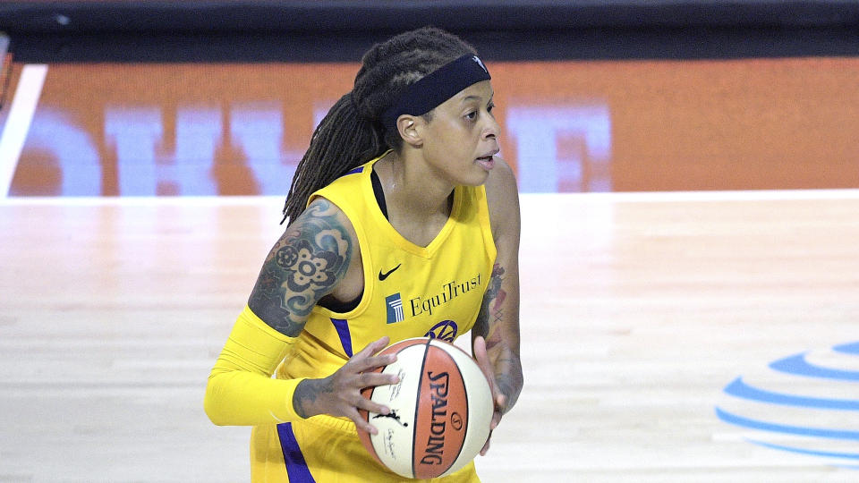 Los Angeles Sparks guard Seimone Augustus (33) sets up a play during the first half of a WNBA basketball game against the Phoenix Mercury, Saturday, July 25, 2020, in Bradenton, Fla. (AP Photo/Phelan M. Ebenhack)