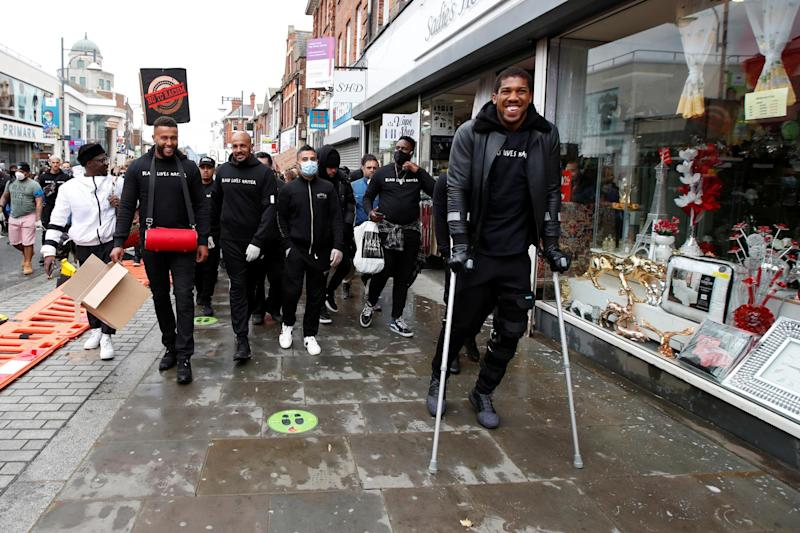 Joshua was pictured on crutches as he marched in his hometown (REUTERS)
