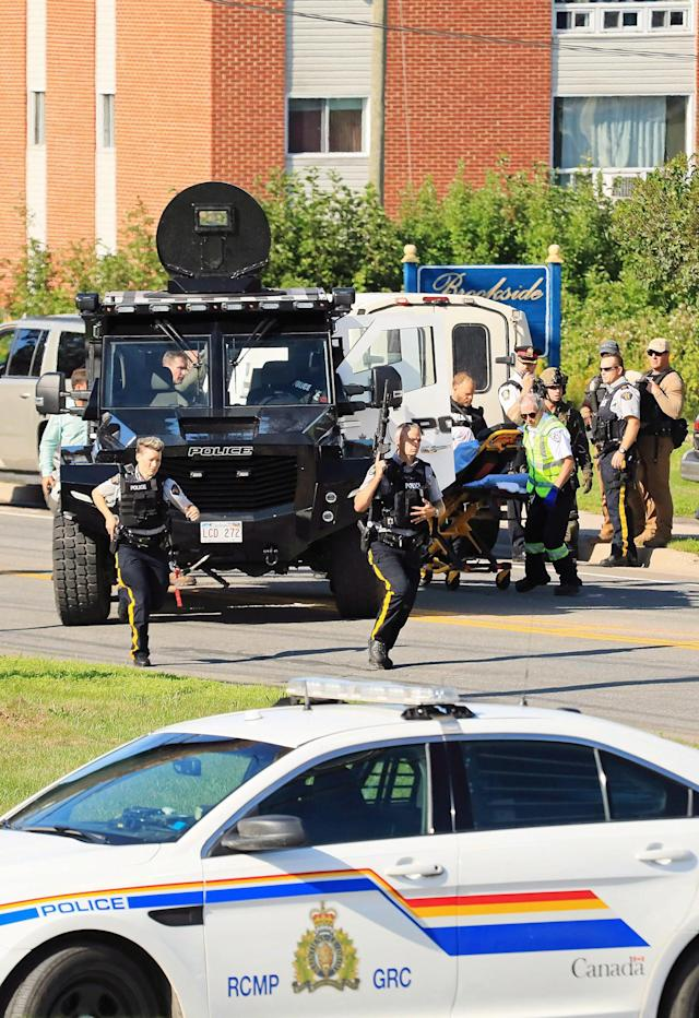 <p>Constables Robb Costello and Sara Burns were killed while responding to a report of gunfire at an apartment complex on the city's north side the morning of Aug. 10.<br>They were the first on the scene and were gunned down as they approached slain civilians Donnie Robichaud, 42, and his girlfriend, Bobbie Lee Wright, 32.<br>The alleged shooter, Matthew Vincent Raymond, was quickly arrested but a heavy police presence surrounded the building for the rest of the day. (Photo from The Canadian Press/Keith Minchin) </p>