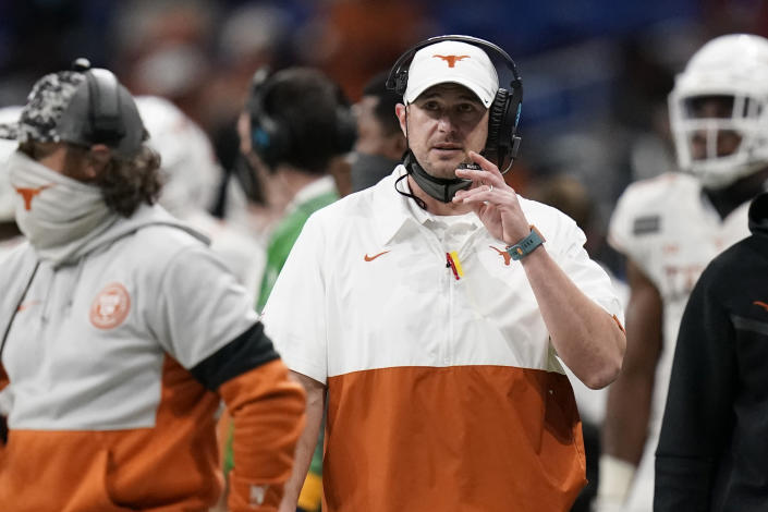 Texas coach Tom Herman watches from the sideline during the first half of the team's Alamo Bowl on Dec. 29, 2020. (AP)