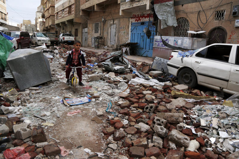 A Yemeni boy rides a bike on rubble of houses destroyed in a recent airstrike carried out by warplanes of the Saudi-led coalition, on May 23, 2019, in Sanaa, Yemen. (Photo: Mohammed Hamoud/Getty Images)