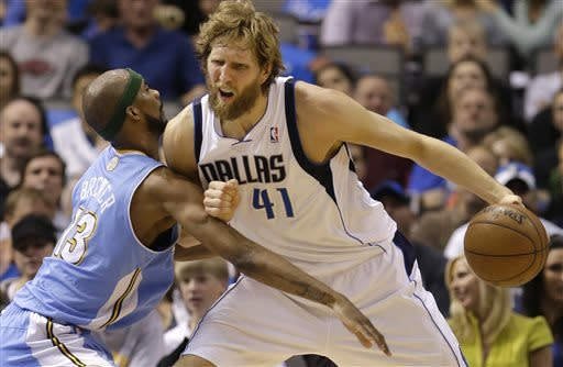 Dallas Mavericks power forward Dirk Nowitzki (41), of Germany, is fouled by Denver Nuggets small forward Corey Brewer (13) during the first half of an NBA basketball game on Friday, April 12, 2013, in Dallas. (AP Photo/LM Otero)