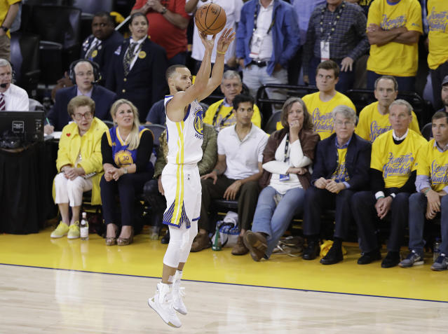 Steph Curry's desperation three right before halftime had big implications on Game 1 of the NBA Finals. (AP Photo)