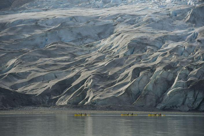<p>The people kayaking in front of the Reid Glacier in Glacier Bay National Park, Alaska, really illustrate the true scale of the ice caps. // January 1, 2012</p>