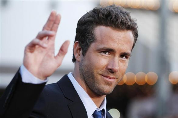 """Ryan Reynolds waves at the world premiere of the film """"The Change-Up"""" in Los Angeles August 1, 2011."""
