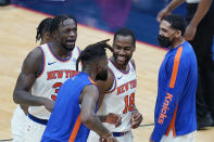 New York Knicks guard Alec Burks (18) celebrates his 3-point basket with teammates as he walks to the bench for a timeout in the second half of an NBA basketball game against the New Orleans Pelicans in New Orleans, Wednesday, April 14, 2021. The Knicks won 116-106. (AP Photo/Gerald Herbert)