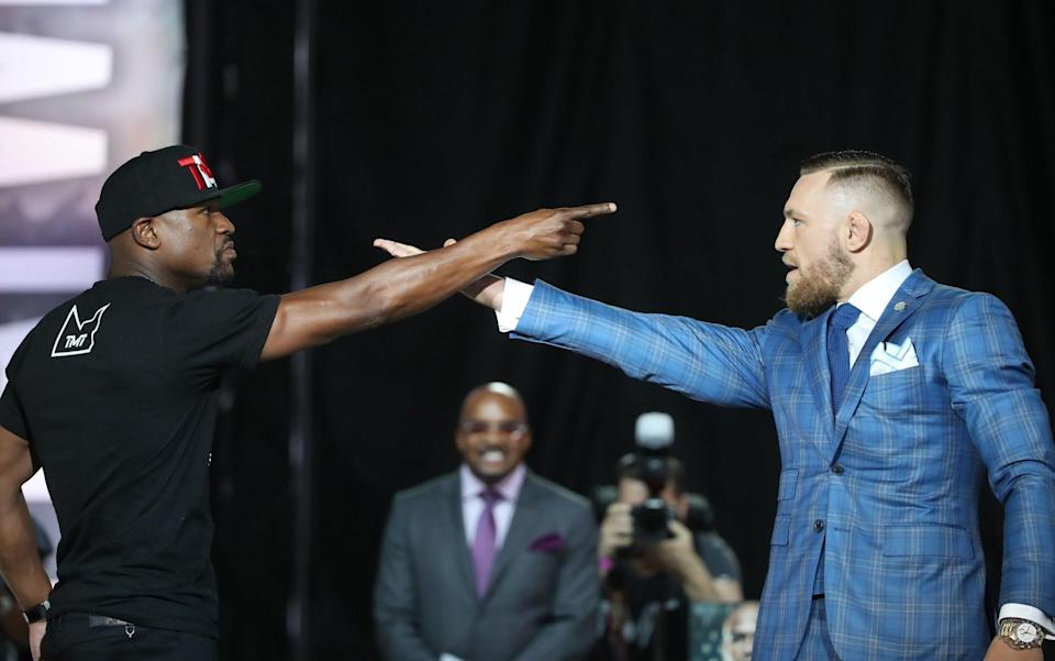 Floyd Mayweather and Conor McGregor face off at one of their press conferences.