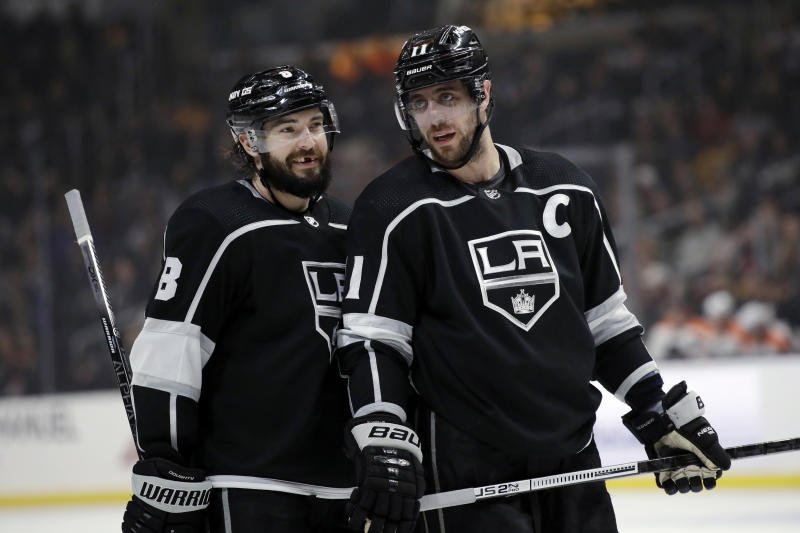 Los Angeles Kings' Anze Kopitar, right, talks to Drew Doughty during the second period of an NHL hockey game against the Philadelphia Flyers Tuesday, Dec. 31, 2019, in Los Angeles. (AP Photo/Marcio Jose Sanchez)